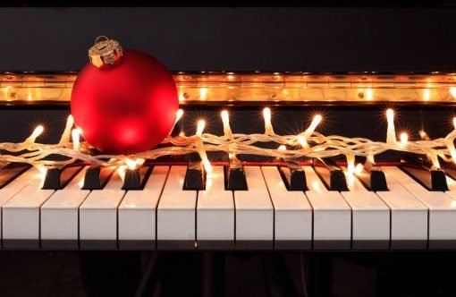 red christmas ornament on piano